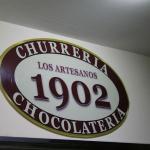 Logo de la chocolatería Los Artesanos 1902 de Madrid