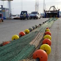 Red pesquera en el puerto de Palamós